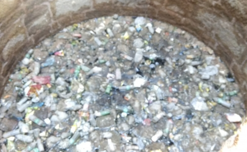 Water inside the well of Rajon ki Baoli. Water was filled with garbage.
